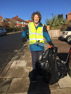 Cllr Wendy Taylor cleans up